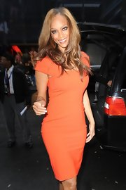 Tyra Banks was perfection in this orange shift dress for her visit to 'Good Morning America.'