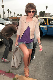 Frankie Sandford stood tall in a pair of summery woven leather wedges.