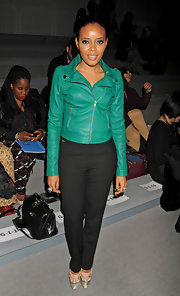 Angela Simmons' black skinny pants really made her green jacket pop at the Concept Korea fashion show.