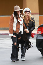Vanessa Hudgens embraced a boho style in a suede and sheepskin bomber jacket.