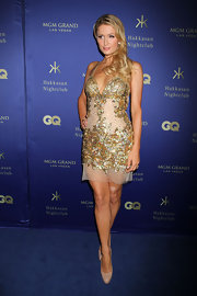 Paris Hilton sparkled in a little gold number while out in Las Vegas.