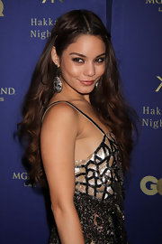 Vanessa Hudgens wore her voluminous curls mostly down with a softly twisted half-up style in Las Vegas.
