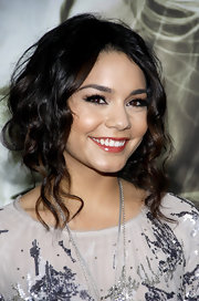 Vanessa Hudgens opted for a loose updo at the premiere of 'Sucker Punch.' She allowed long tendrils to frame her face.