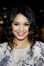 Vanessa Hudgens paired her natural look with a touch of cherry gloss. She added a touch of sparkle to her look with silver shadow lined at her inner eye.