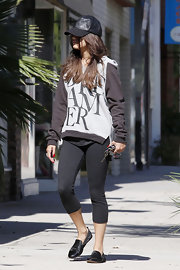 Vanessa Hudgens sported this crisp black leather baseball cap while out in California.