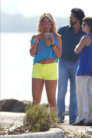 "Vanessa Hudgens looked like she stepped out of the '80s on the set of ""Spring Breakers"" in a blue crop top and bright yellow shorts."