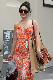Vanessa Hudgens matched her bohemian maxi dress with a distressed leather satchel.