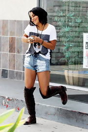 Vanessa Hudgens was out and about LA in distressed denim shorts paired with a white graphic tee. She finished off the look with knee-high boots.
