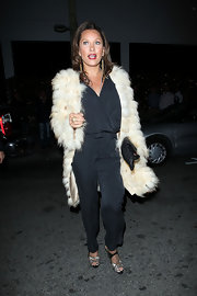 Vanessa Williams paired her silky jumpsuit with futuristic silver and black peep toes.