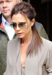 Victoria Beckham chose a messy ponytail for her chic and casual look while out in London.