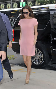 Victoria Beckham looked sweet as can be preparing for fashion week in a petal pink shift dress.