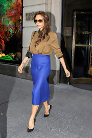 Victoria chose this brown and black collared button down for her sleek and sophisticated look while out in NYC.