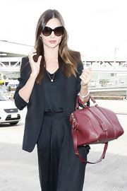 Miranda Kerr kept her monochromatic travel style elegant with a black blazer.