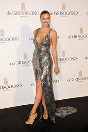 Irina was dripping in liquid silver at Cannes wearing this trained silver gown.