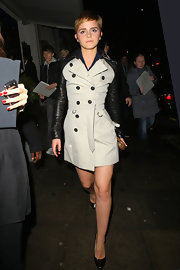 Emma Watson went for the unexpected and wore an edgy trench with black leather sleeves and collar at Mahiki Nightclub in London.