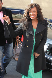 Wendy Raquel Robinson paired a classic black pea coat with her mint dress for a totally stylish finish.