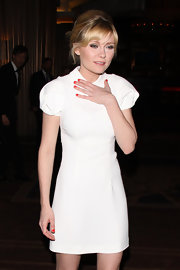 Kirsten Dunst added a vibrant touch to her look with fiery red nail polish.