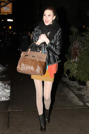 Whitney Port added a luxe touch to her street attire with a brown pony hair bag.