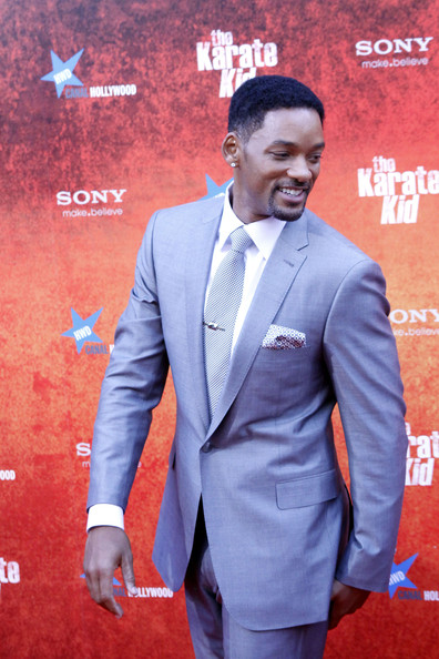 Will Smith showed off his dapper style in a grey suit and pocket scarf.