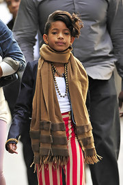 Willow Smith looked cozy as can be in a caramel scarf while leaving her NYC hotel.