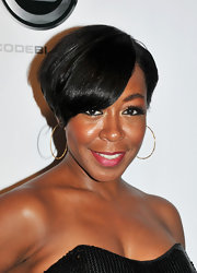 Tichina Arnold wore her hair short with a side part and emo bangs at the 'Laugh at My Pain' premiere.