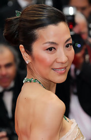 Actress Michelle Yeoh showed off a smooth classic bun while hitting the Cannes Film Festival. Her jade green jewels were the perfect compliment to her look.