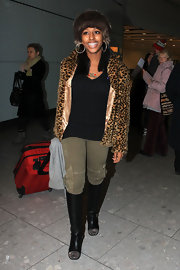 Alexandra strolled through the airport in black knee high boots with stud-embellished toes.
