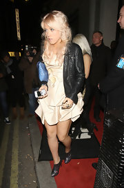 Amelia Lily balanced her feminine gathered satin dress with a blue ostrich clutch and a black leather jacket.