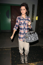 Cher Lloyd showed off a printed zebra bag while hitting the X factor studios.