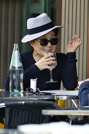 Yoko Ono sported a pair of classy dark-lensed shades with gold details as she was spotted enjoying a meal at Da Silvano in New York.