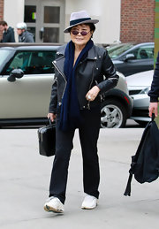 Yoko Ono added charm to her look by donning a tilted gray fedora.