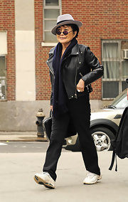 Yoko Ono confidently trawled the streets of New York City in a pair of black slacks.