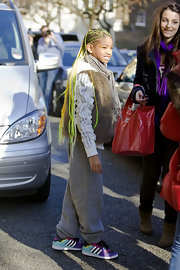 Willow Smith was spotted leaving her London hotel in baby blue and purple Adidas sneakers.