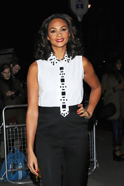 Alesha Dixon looked funky at the Cosmopolitan Ultimate Women of the Year Awards in a sleeveless white top with an embellished collar and a matching beaded tie.