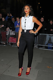 Alesha Dixon matched black high-waist pants with an embellished top for a smart look during the the Cosmopolitan Ultimate Women of the Year Awards.