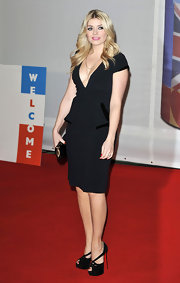 Holly Willoughby stuck to a fashion staple when she chose this basic LBD with a velvet peplum waist.