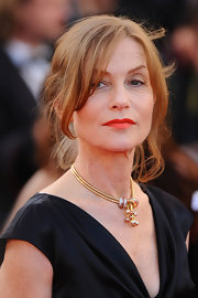 Isabelle Huppert finished off her fab look with a swipe of red lipstick.