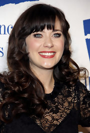 Zooey Deschanel attended the Annual Alliance for Children's Rights Dinner wearing her long hair in bouncy curls.