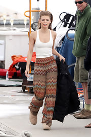 AnnaLynne McCord was spotted on set in a pair of bold zigzag knit high waist pants and sheepskin boots.