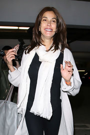 Teri smiles sweetly in a thick white scarf and her black and white ensemble while out at the theater.
