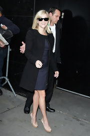 Reese Witherspoon teamed her sophisticated navy frock with nude platform peep-toe pumps.