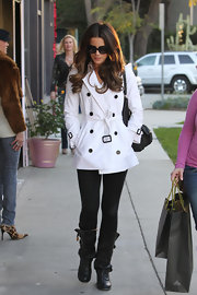 Kate Beckinsale showcased her elegant street style in a timeless white trench and black leggings.