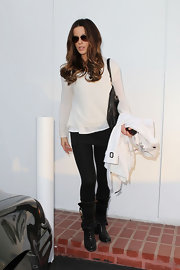 Kate Beckinsale was on point while shopping in a sheer ivory sweater and fitted black leggings.