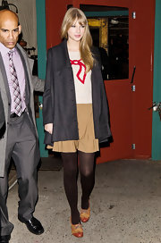 Taylor Swift topped off her whimsical sweater with brown Oxfords.