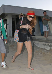 Lindsay Lohan laid low underneath a small straw hat and major glamour glasses as she hid her face from the paparazzi.