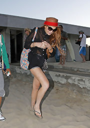 Lindsay Lohan brought some color to her beachwear with her fun floral-printed tote.