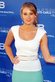 Kim Matula emphasized her curves by wearing a wide belt over her top and skirt ensemble at the Monte Carlo TV Fest.