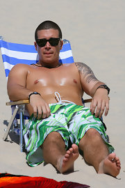 Jersey Shore's Vinny protects eyes with his Ray-Ban Wayfarers while putting the T (or tan) in GTL.