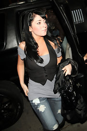 Angelina Pivarnick spruced up a simple gray top with a black vest.