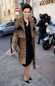 Farida dons a leopard print evening coat with a fur texture to the Giambattista Valli show in Paris.